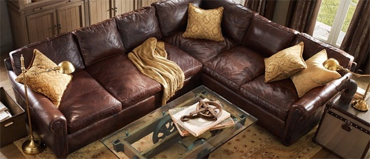 I'm not suggesting this couch..but thinking of your current leather couch that's by the doorway...if/when you get rid of the other couch set, perhaps finding another full length couch with that same deep leather coloring and topping with light colored pillows. That could look super hot and rustic at the same time.