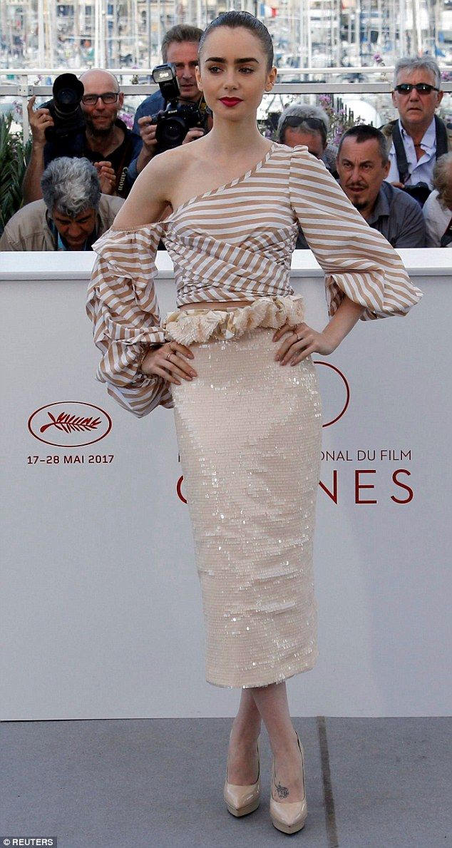 Style maven: Lily Collins, 28, was back to her sartorial tricks as she stepped out at the Cannes Film Festival in a fashion forward ensemble on Friday