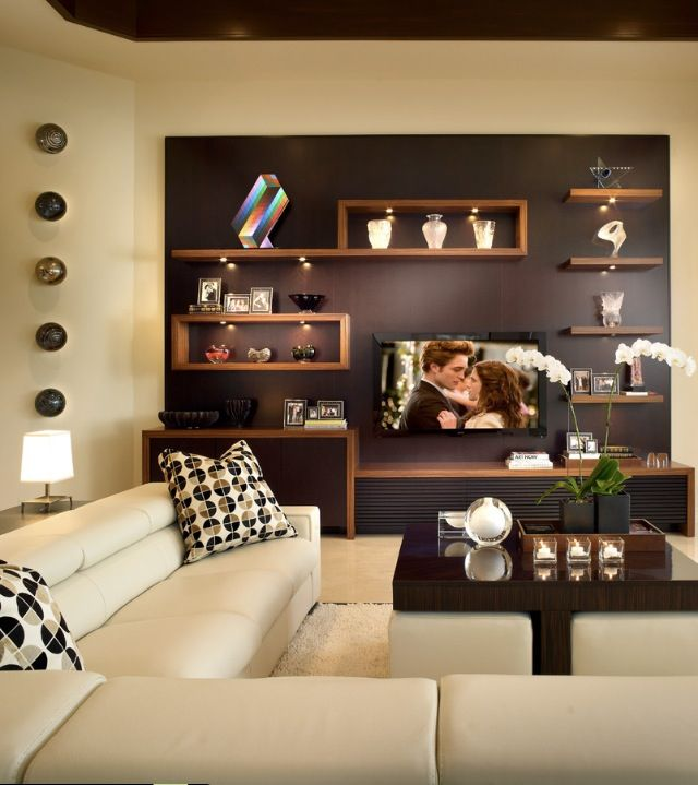I love the wall! The screen blends with the shelves and doesn't dominate the room.