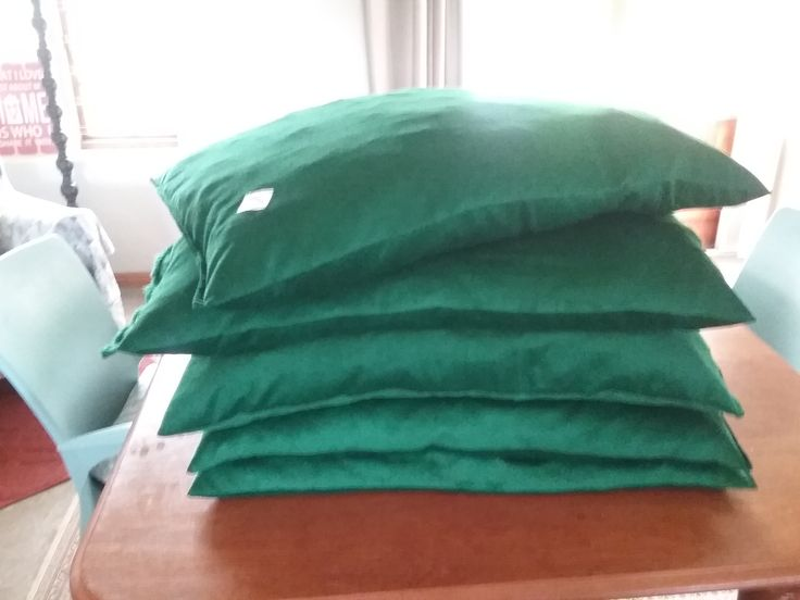 5 dog beds made by KRD (Kensington Rescue Dog company)  for animal rescue in Cape Town. The cover is soft green  baby corduroy and the inner is fabric scraps cut into small pieces - we don't waste anything.