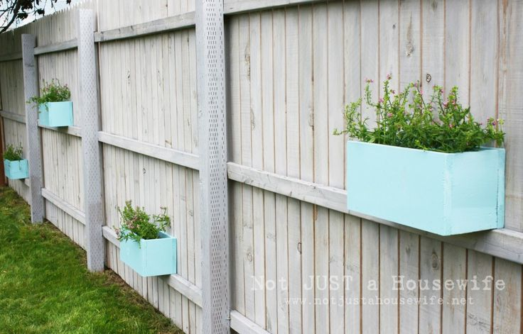 Planter boxes on the fence. hmm lavender, lemon grass, basil & other fragrant herbs would be nice