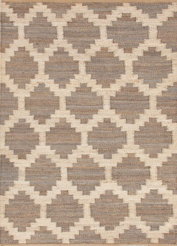 This hand-woven flatweave area rug offers rustic charm and global inspiration with a natural hemp construction. A Moroccan tile-inspired trellis design creates an eye-catching pattern, lending chic contrast in white and neutral heathered gray.