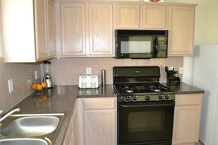 kitchens with white appliances and oak cabinets 1000 images about kitchens with black appliances on 9860