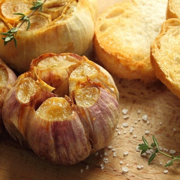 Roasted garlic - SO tasty and so good for you! Check out how to make your own garlic roaster for garden fresh flavor!