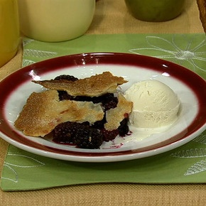 Carla Hall's Blackberry Pot Pie ---she says to bake the bottom crust first, then put it in the pan with the blackberries on top of it