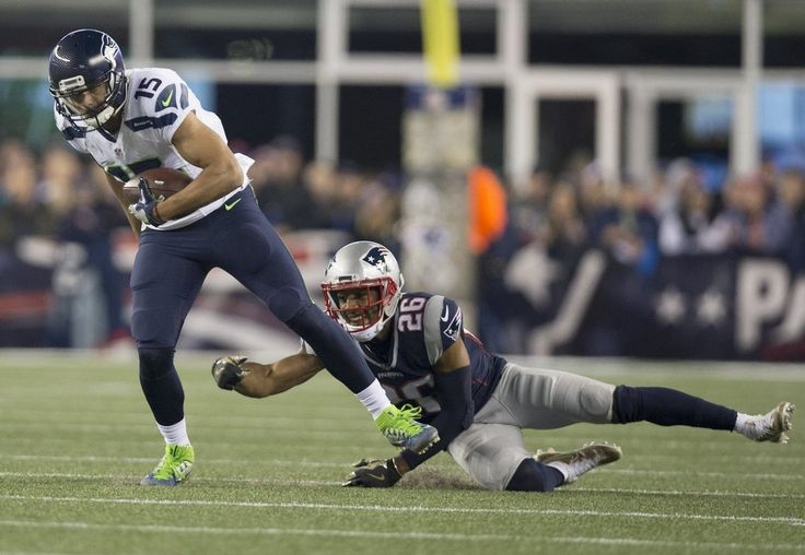 Seahawks vs. Patriots:  31-24, Seahawks  -  November 10, 2016  -    Seattle Seahawks wide receiver Jermaine Kearse (15) shakes a tackle attempt by New England Patriots cornerback Logan Ryan (26) during the second quarter. (Dean Rutz / The Seattle Times)