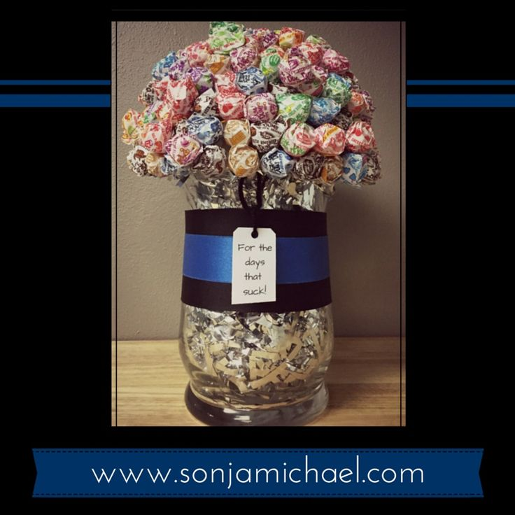 """""""For the Days That Suck"""" police 'Thin Blue Line"""" sucker Dum-Dum candy arrangement. Here is a HOW-TO on making this cute craft that can be used for several different occasions or holiday. Quick, easy, and inexpensive gift idea!"""
