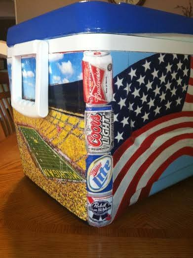 Painted beer cans on the side of a frat cooler