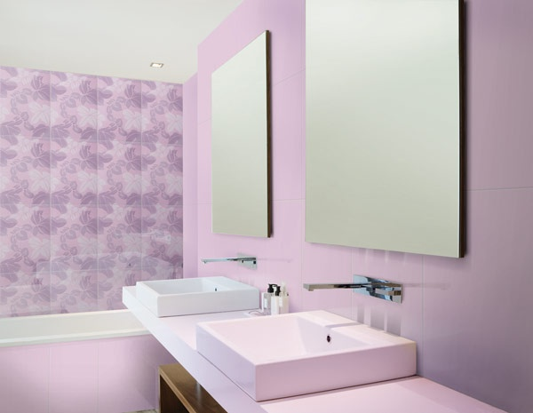 Daring #purple #ceramic tiles clad the walls of this #bathroom, accentuated by a floral motif feature wall. #UnionTiles