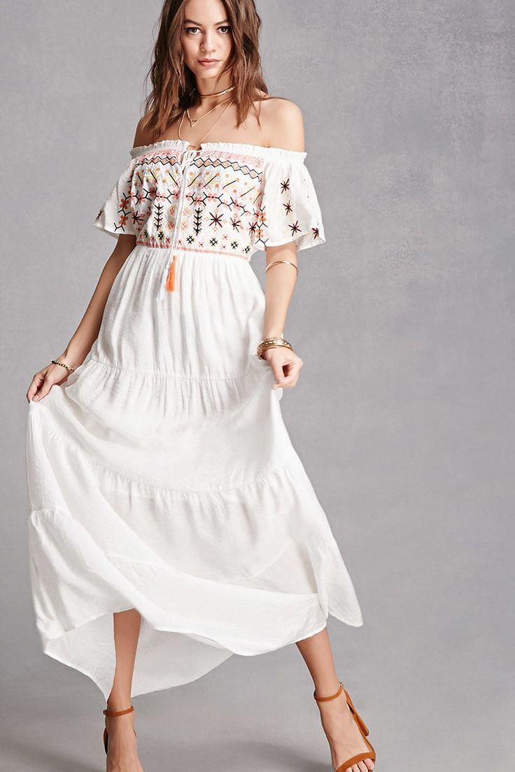 A woven maxi dress featuring an off-the-shoulder neckline with a self-tie tassel closure, abstract floral embroidery along the bust and short sleeves, an elasticized waist, and a tiered skirt. This is an independent brand and not a Forever 21 branded item.