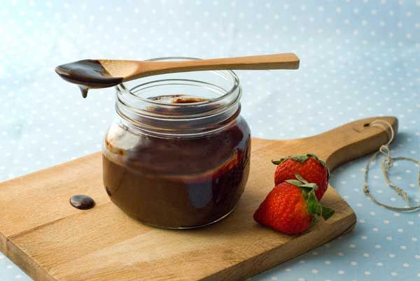 Gluten Free Guilt Free Fudge Sauce Recipe with water, coconut sugar, unsweetened cocoa powder, instant espresso powder (optional), and pure vanilla extract.