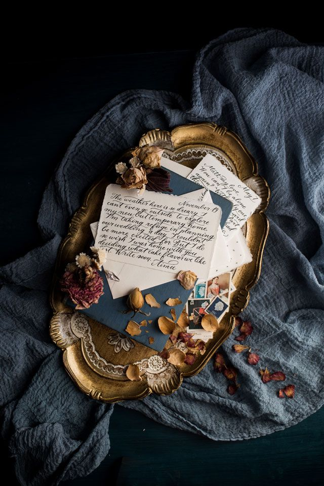 a stunning vintage proposal inspiration shoot featuring a love story told through handwritten letters by erin tetterton photography