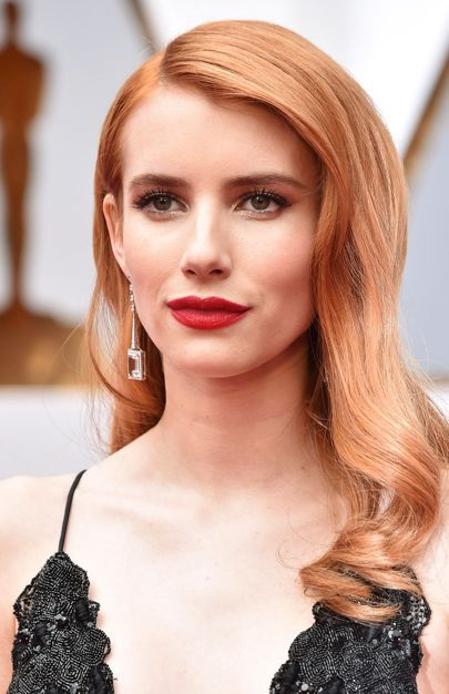 Matt scarlet lips and a new auburn hair hue were the focal points of Emma Roberts's red-carpet look.