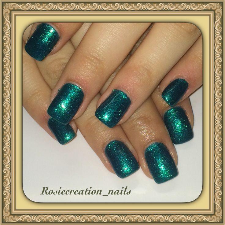 Green gel nails with shimmer , holiday nails