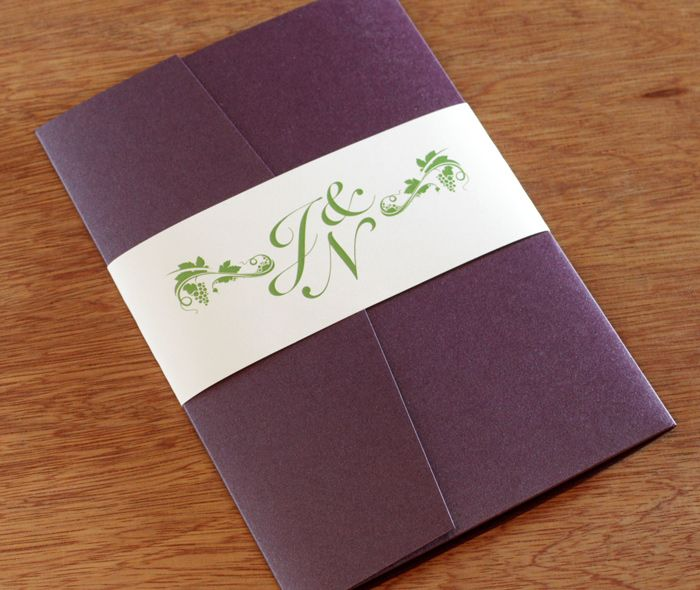 Custom monogrammed  belly band with grapevines and wrapped around a plum pocket folder for a vineyard wedding.  | Invitations by Ajalon | invitationsbyajalon.com