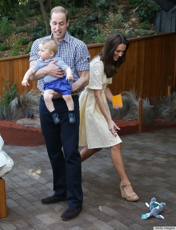 Kate quickly retrieves the toy bilby gift that George tossed away. William's face is priceless.