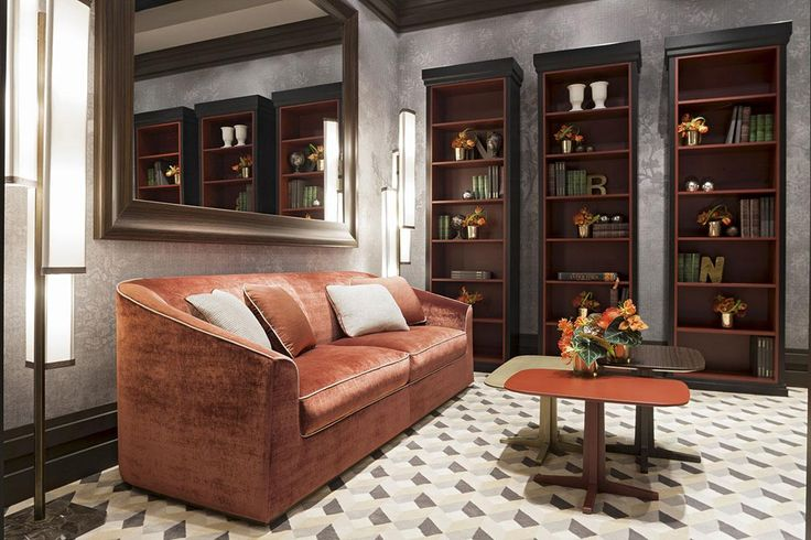 A perfect reading room, with Clarisse sofa, Luis nest of tables and three Lorenzo bookcases, all by Oasis. The Lorenzo bookcase can be wooden or lacquered finishes.