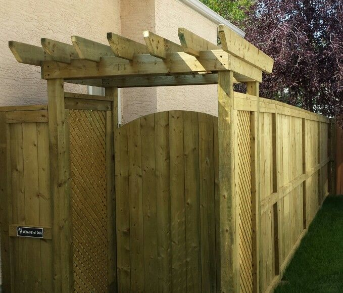 Custom small pergola over gate entrance with privacy for Fortress fence design