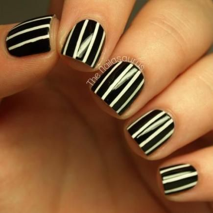 These black-and-white pinstripe nails are classic, clean, and match any outfit for any season. #nails #b&w