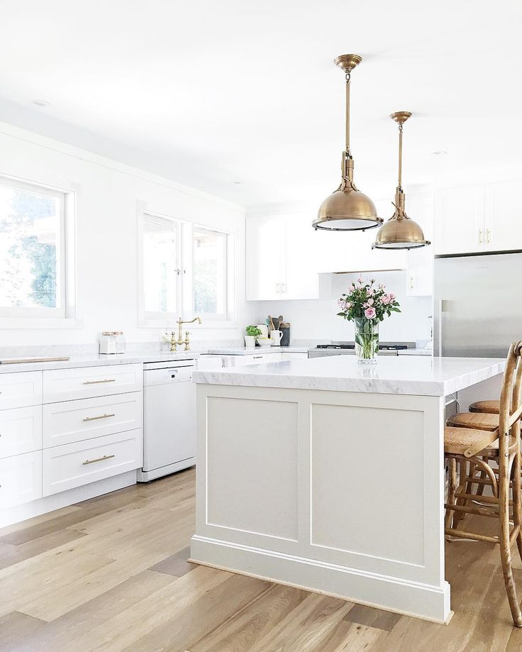 Modern farmhouse kitchen. Island in Dulux 'Pale Tendril' and perimeter cabinetry in Dulux 'Vivid White'. Brass hardware. French oak engineered flooring. Restoration Hardware brass pendant lights. | Design, styling and photo by @cottonwoodinteriors