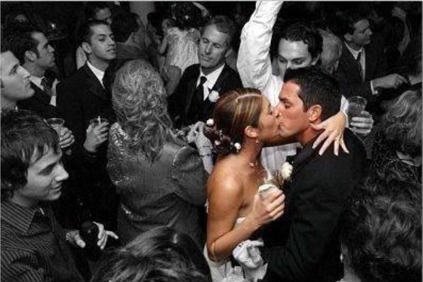 With only the bride and groom in color, it appears time has stopped... Awesome photography!!  Wedding pictures