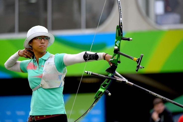 San Yu Htwe of Myanmar competes during an archery event at Sambodromo in the Rio 2016 Summer Olympic Games.  -  Best images from Aug. 11 at the Rio Olympics