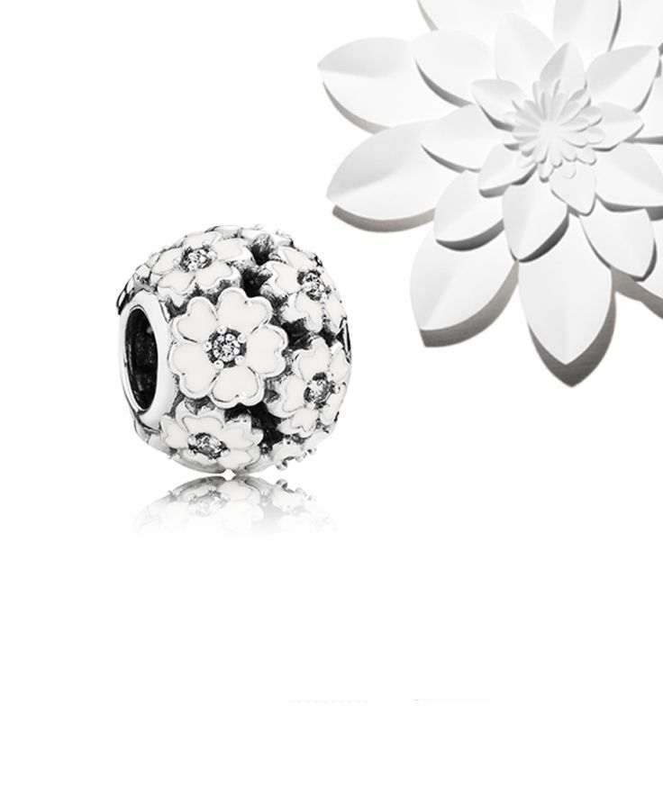 PANDORA Primrose Meadow charm. Each of the 12 graceful flowers is embellished with hand-applied enamel and a clear cubic zirconia that makes it sparkle.