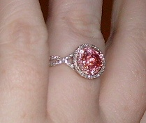 Padparadscha Sapphire center stone, light pink sapphire halo and then diamond halo. Gorgeous ring!