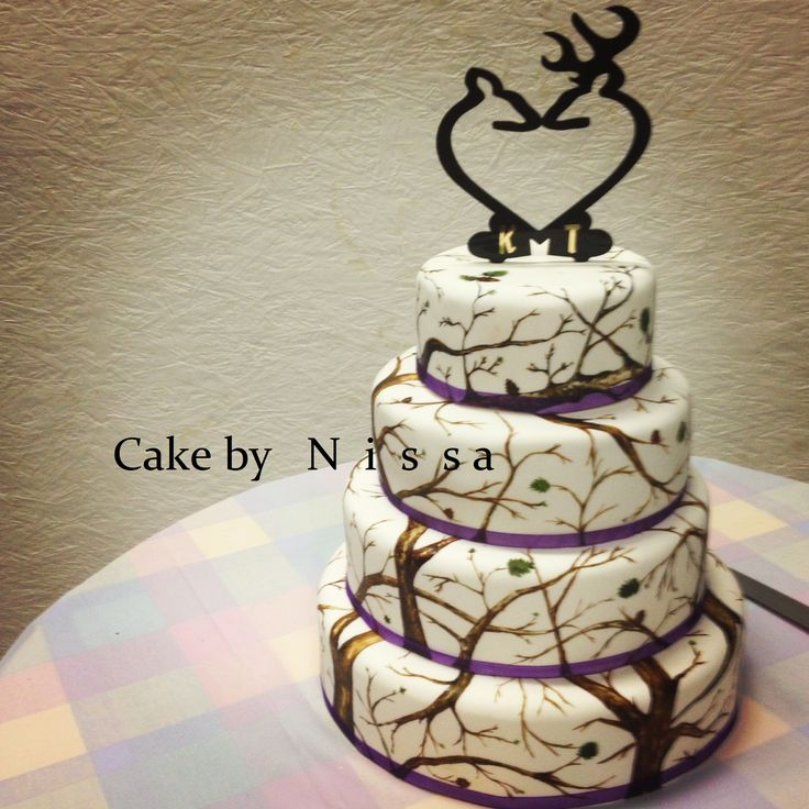- White (winter) camo cake, handpainted (took about 12 hours!) for a fall wedding.