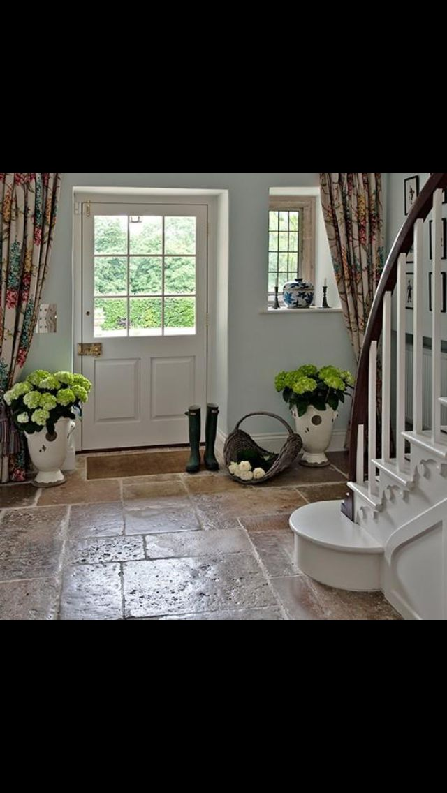 Floor idea and decor feel for the entrance into house from garage and into the laundry room?