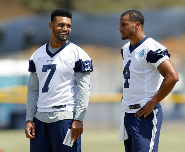 Dallas Cowboys quarterbacks Jameill Showers (7) and Dak Prescott (4) visit while watching the first team work during morning walk-thru at training camp in Oxnard, California, Saturday, August 6, 2016. (Tom Fox/The Dallas Morning News)