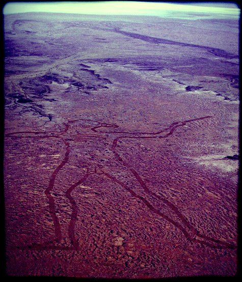 """Australia boasts a geoglyph that's larger than Peru's """"Nazca Lines"""" and England's """"White Horse"""". Called the """"Marree Man"""", the pictograph measures 4.2 km tall by 2 km wide and is etched into a plateau near Marree. It depicts an Aboriginal warrior throwing a hunting stick and is so large that it can be viewed fully only from the air. """"Marree Man"""" was discovered by a charter pilot in 1998 and, despite being the world's largest geoglyph, its origin remains a mystery. — with Debbie Borgono"""