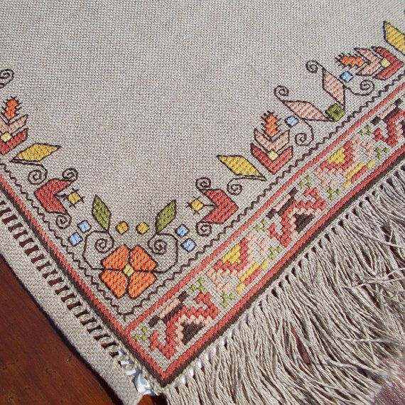 Hand embroidered table runner, table topper with Bulgarian motifs. Discover this decorative and beautiful handmade linen table runner from our exclusive collection of Bulgarian embroideries. Bulgarian embroidery is one of the traditional Bulgarian crafts, used to decorate clothing - shirts,
