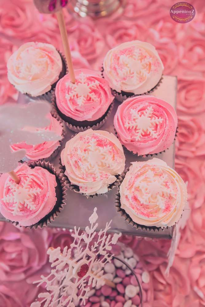 Pink snowflake cupcakes at a Winter Wonderland birthday party! See more party ideas at CatchMyParty.com!