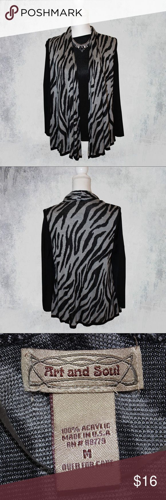 "Art and Soul Animal Print Vest This adorable vest is so versatile. You can wear it to work or out for date night.   * Colors - Black and gray * Stretchy * Longer sides than back * Material gathers at back of neck so it cascades down the sides in the front * 100% acrylic  MEASUREMENTS   * Armpit to pit 19.5"" * Waist 42"" * Hips 48"" * Length sides 31"" * Length back 25""  This vest, by Art and Soul, is in great condition - no flaws - and is a size Medium. Art And Soul Tops"
