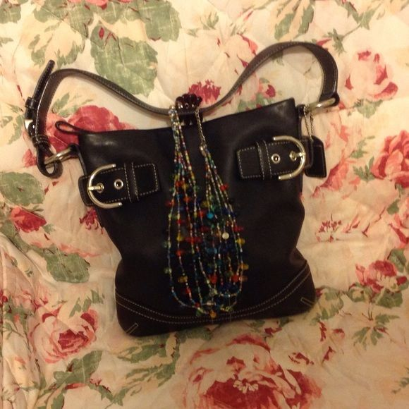 Black Coach Purse  jewelry not included Black Coach purse very nice condition with 2 front belt buckle Coach Bags Satchels