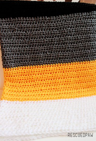 Make this simple PIttsburgh Crochet Throw Blanket with this FREE crochet Afghan Pattern! Find this and many more FREE Patterns at Rescued Paw Designs.