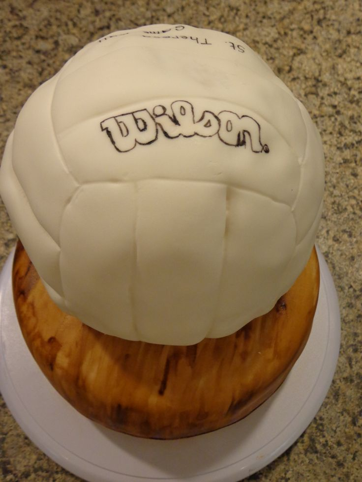 A volleyball cake for the champions... first time using rice krispies with fondant.