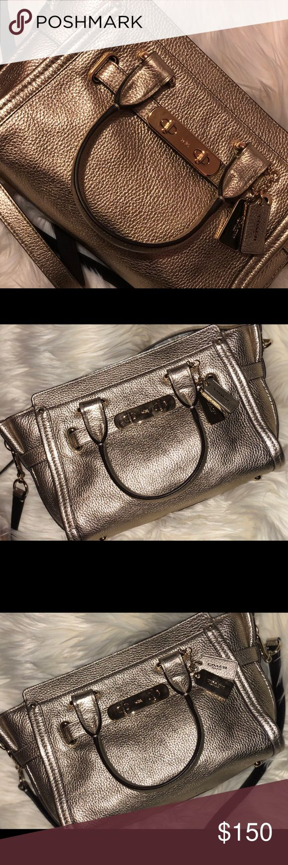 ❗️100% AUTHENTIC RETAIL SWAGGER COACH BAG❗️ This bag is carried in a platinum color, which is golden but soooooooooo beautiful. It is pebble leather, so it is soft but still holds a shape and comes with a crossbody attachment that matches. The metal on the bag has not faded and shows VERY VERY minor scratches. Not noticeable. The leather itself is in great condition except for one spot under which is shown in picture. Not noticeable, also on very bottom of bag. Pockets. Inside and zipper…