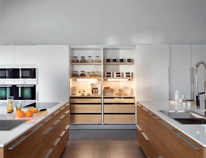 SANTOS kitchen. 2011  The coplanar sliding door system is introduced which permits greater visibility and easier access to the interior of the unit. Once they are closed, the doors line up perfectly. Interior accessories in wood are developed respecting their natural beauty.  Series Walnut Wood Natura