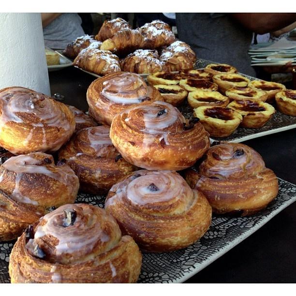 Pastries including Danish, pasteis de nata, chorizo egg tartlets and almond croissants  from Jason bakery - an artisanal baker in Bree Street
