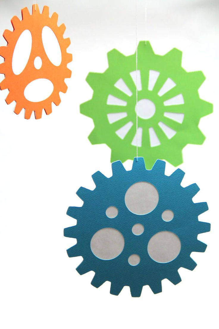 Add a whimsical detail to your robot party! This set of 3 large die cut gears would be a perfect addition! They are bright, colorful, and oh so fun!  These were designed as part of the Robots & Gears collection of items. Please see the last photo for coordinating digital products  This set includes: 3 large die cut gears  SIZE: - Green gear is approximately 8 in diameter - Aqua gear is approximately 6 in diameter - Orange gear is approximately 4 in diameter  All gears are die cut from…