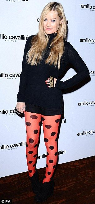 Laura Whitmore does brights with spotted orange tights