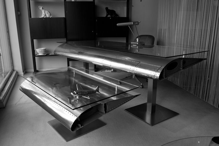 Relicta.  Created and realize furniture out of old aircrafts coming from different aircraft bone yards in the world.