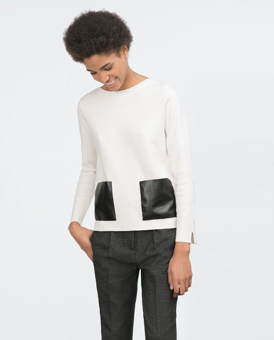 TOP WITH FAUX LEATHER POCKETS