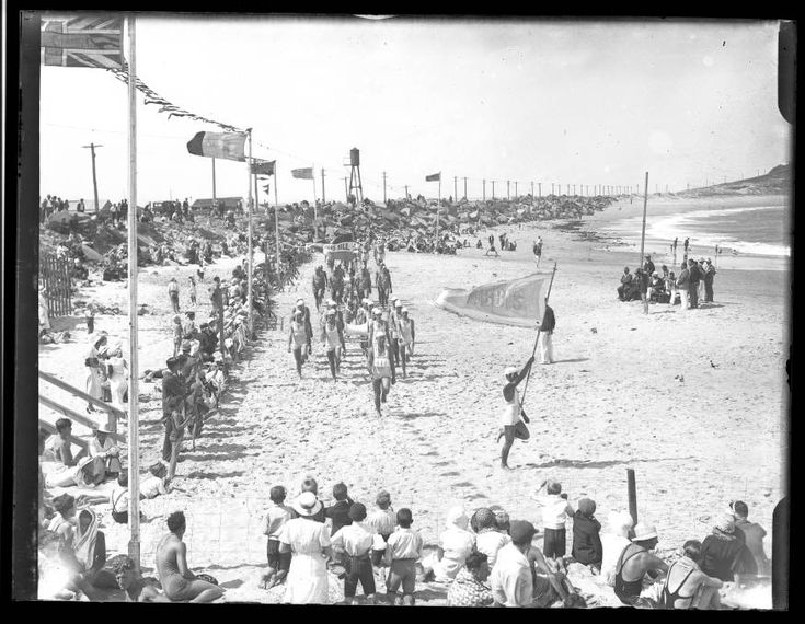 Crowd gathered at the beach [Nobby's], c.1930's. This photograph was scanned from a glass or film negative in the archives of The Newcastle Sun newspaper which are held by Cultural Collections at the University of Newcastle, Australia.
