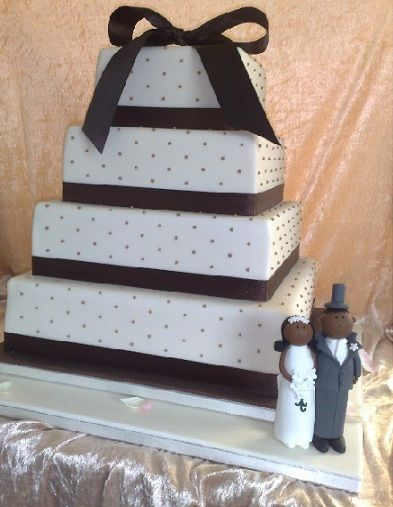 Brown And Ivory Dotty Four Tier Wedding Cake With Decorative Bow Topper Bride Groom
