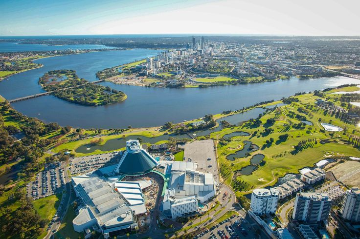 A lovely aerial shot of Perth, encompassing Heirisson Island, the Swan River, Crown Perth, the ocean and beyond.