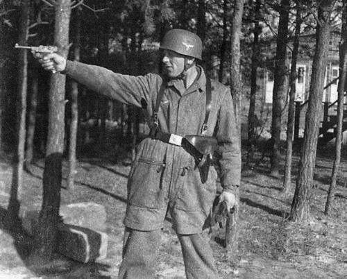 German Paratrooper Firing Luger