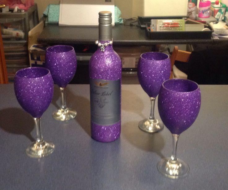 Bottle of red wine & 4 wine glasses glittered in purple.